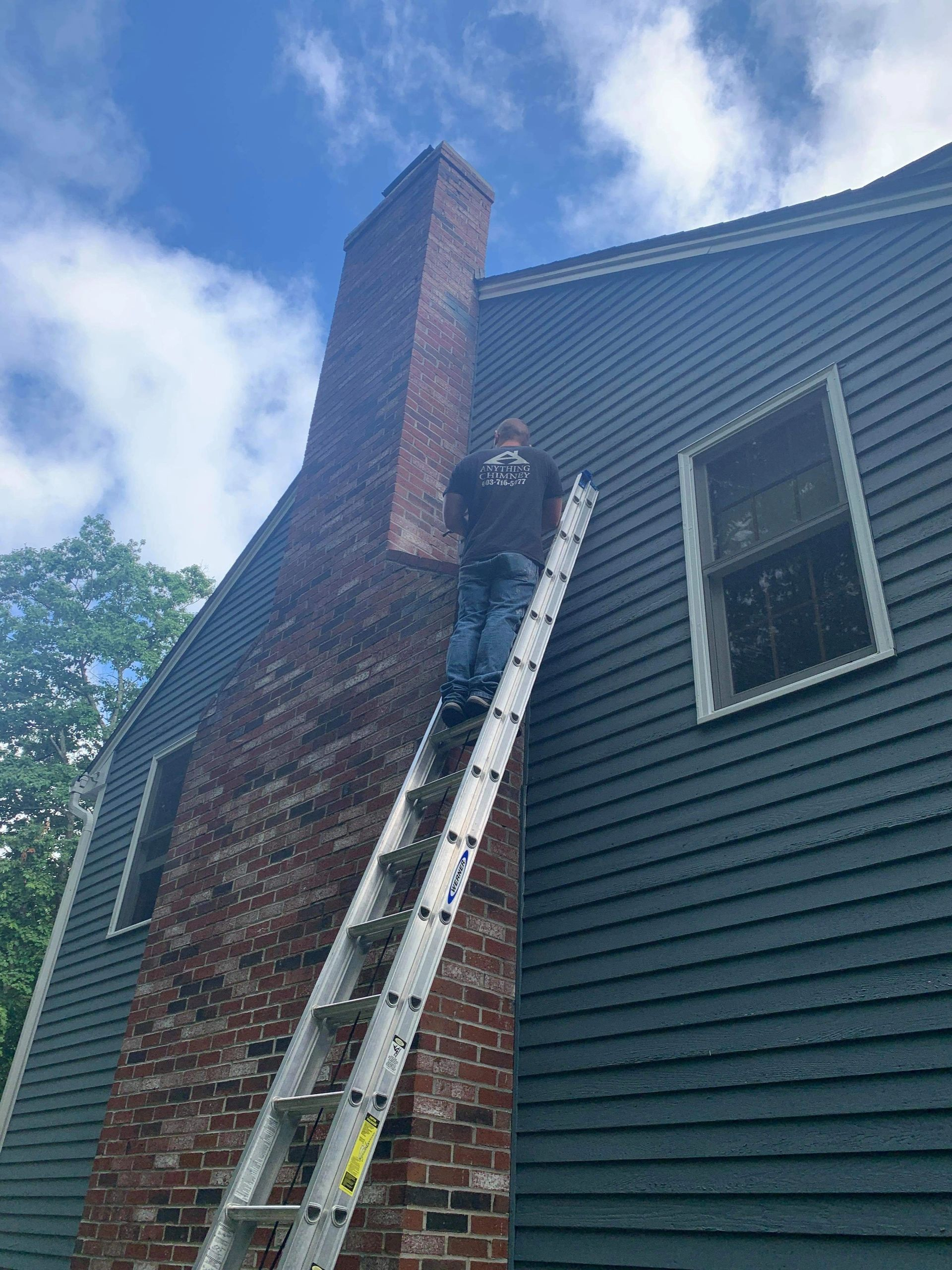 A photo of a chimney shoulder repair in Concord, NH.