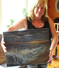 Wendi Fox with one of her paintings