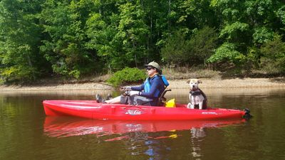 Carly Hylen fly fishes on a kayak with her dog