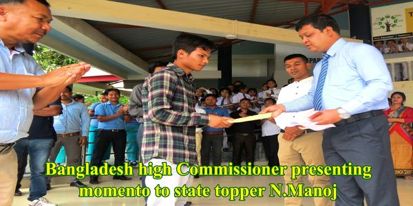 Bangladesh High Commissioner to India congratulating Nongmaithem Manoj who scored 94.2% .