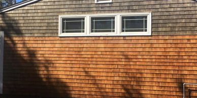 Dramatic change in appearance after cleaning shingles on side of house