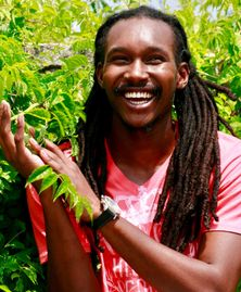 Reggae artist Ishmael Turner being inspired by the energy of a beautiful tree.