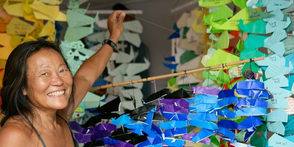 Peggy Oki with the Origami Whales Project. Photo by Matt Dayka.