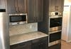 Double wall oven and built in microwave in custom cabinetry with Quartz countertops