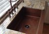 Hammered copper farmhouse sink compliments this bridge style farmhouse faucet beautifully!