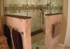 Large walk in shower with zero entry floor and heated seat. Quartz and travertine compliment this space extremely well!