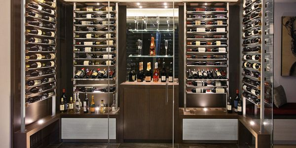 Custom contemporary wood and metal wine cellar.