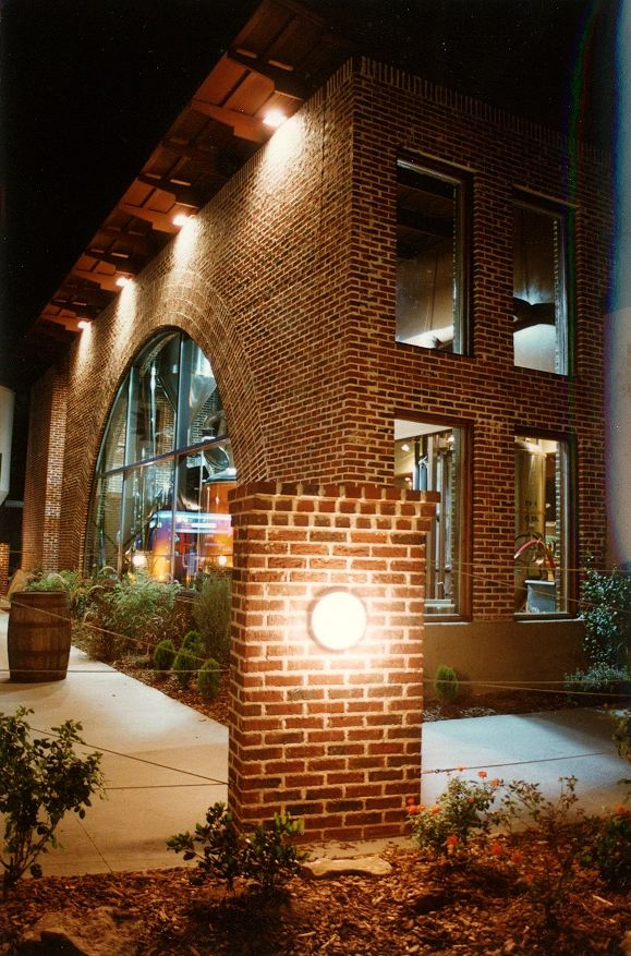 "{""blocks"":[{""key"":""9te3t"",""text"":""The 700 square foot Brew Room is the heart of the facility.  Located centrally on the site, its equipment and processes are visible through windows from the restaurant, bar, patio, and street. The copper-clad kettle and tanks are displayed under a gigantic brick arch. The effect was a display that served as an advertisement for the restaurant, but also a theater in which the patrons participated in the art of craft-brewing as the brewmaster began his night's activities. Building materials recall the earlier manufacturing buildings of the region:  Walls of concrete and brick and timber-framed roofs. Open planning compliment the dining experience by allowing views between Restaurant, Bar, and Brew Room. "",""type"":""unstyled"",""depth"":0,""inlineStyleRanges"":[],""entityRanges"":[],""data"":{}}],""entityMap"":{}}"