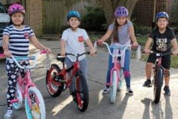 Here are four very happy little ones with new bikes and helmets, compliments of TYKES.NEED.BIKES!