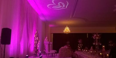 Up-lighting example with wedding rings & heart projection