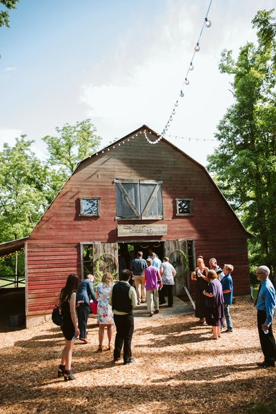 Wedding guests entering Rustic Red Barn