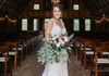 Happy bride inside Rustic Red Barn at Venue 481 | Photo by: Shelby Chante' Photography