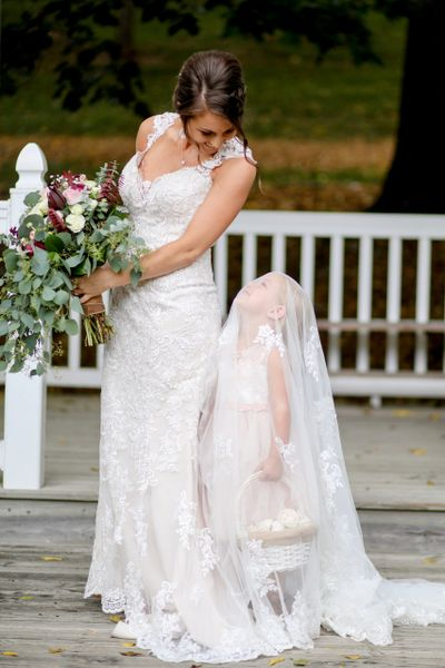 Bride and daughter at white gazebo