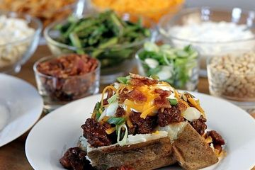Baked potato bar with cheese and bacon