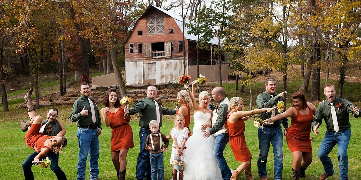 Fun wedding party in front of Rustic Red Barn at Venue 481 | Photo by: Creative Shots Photography