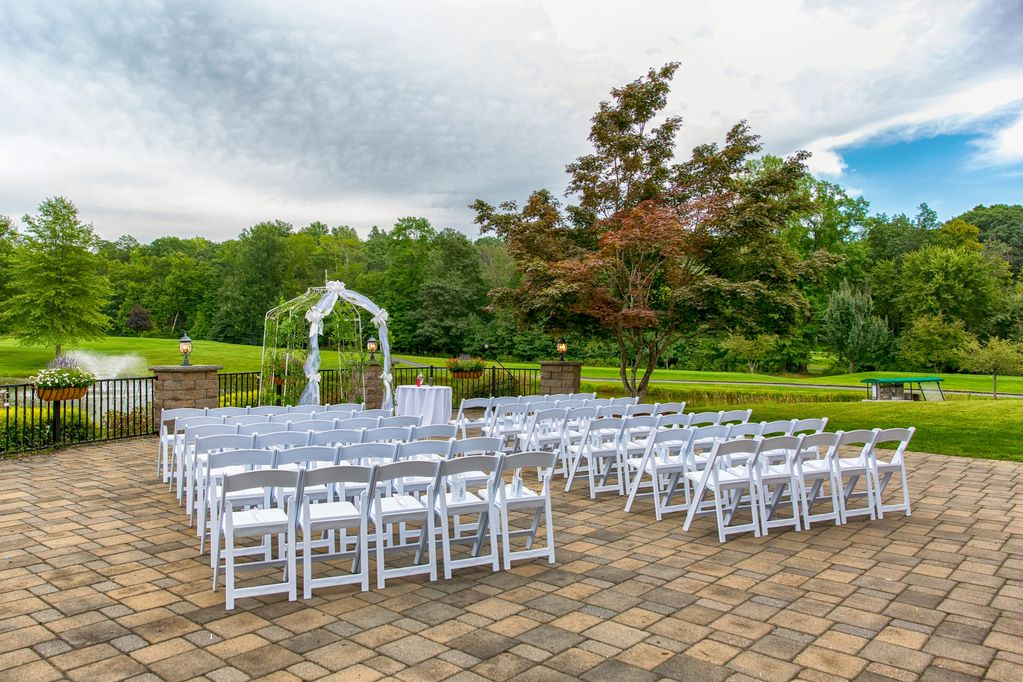 Wedding Ceremony with White Chairs
