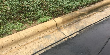 clean curb and dirty curb side by side
