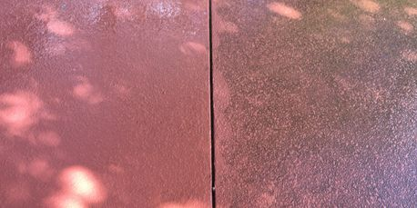Red sealed concrete clean and dirty side by side.