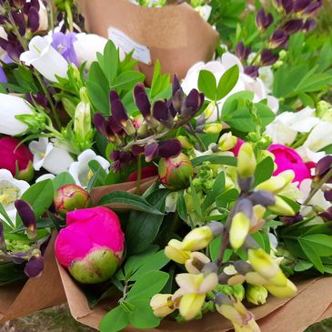 Flower CSA Bouquets full of Peonies, Baptisia and other spring blooms.