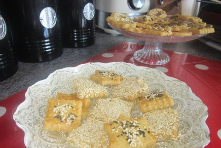 Turkish savoury biscuits on a plate and cake stand, decorated with seeds and nuts