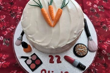carrot cake and cream cheese frosting, fondant carrots and fondant make-up brushes, eye shadow