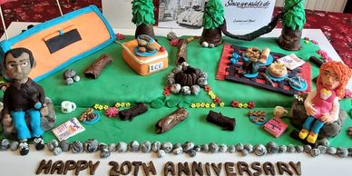 CAMPING THEMED CAKE -with tent, trees, blanket, people, flowers, logs, stones & foods