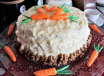 carrot cake with cream cheese frosting and handmade fondant carrots