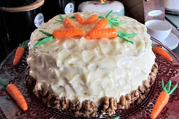 layerd carrot cake with cream cheese frosting and fondant carrot