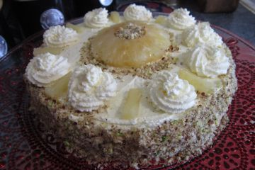 PINEAPPLE GRIESTORTE - semolina genoise cake with whipped piped cream, pineapple, chopped pistachios