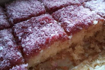 raspberry and coconut sponge cake squares cut up
