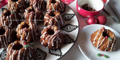 mini gingerbread bundt cakes on a plate, served and with Christimas decoratons and baubles