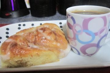 Pioneer woman cinnamon roll served with espresson coffee
