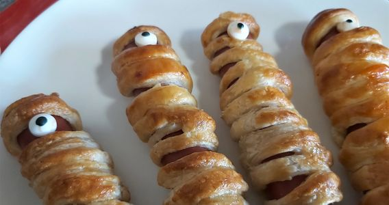 Kids scary mummy sausage rolls from sausages and puff pastry
