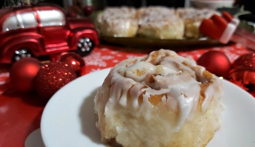 gluten free cinnamon roll on a plate with Christmas decorations