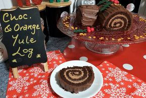gluten free Chocolate orange Yule Log Cake sliced and served for Christmas