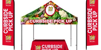 trade show booth includes tents, table throws and flags