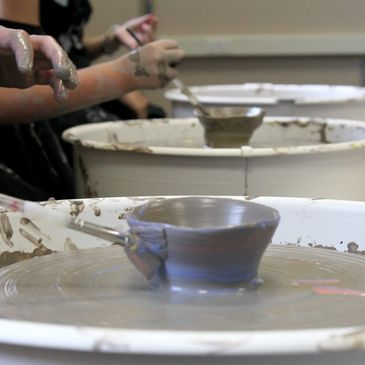 Kids on the pottery wheels at Art Dept Studios