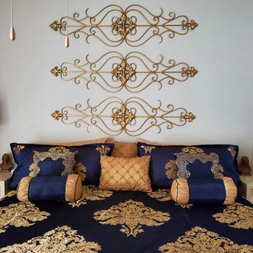 Bedroom decor featuring Pantone's 2020 Color of the year navy blue with gold accents