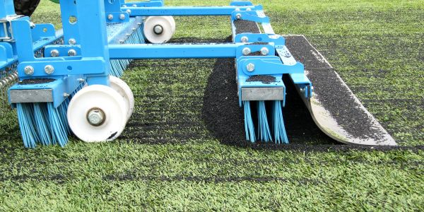 Field brush Modular maintenance brush for artificial turf.