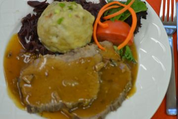 Sauerbraten Bavaria style, served with German bread dumplings or  German potato salad