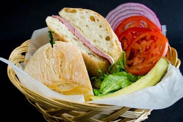German Salami Sandwich served with  choice of bread, cheese , lettuce tomato, onions, pickles.