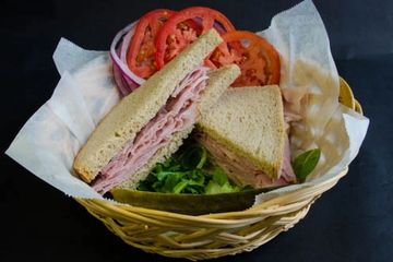 Ham Sandwich with lettuce tomato, onions, mixed greens with sweet or mild german mustard on the side