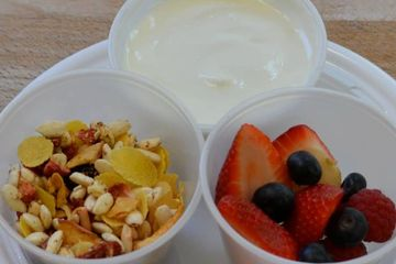 Fresh cup of fruit served with Gluten Free Organic Muesli and Yogurt
