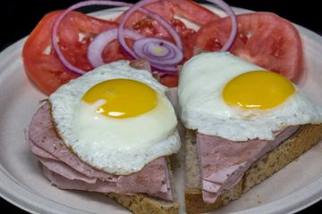 Leberkaesse ( German Meatloaf) Breakfast on Rye bread with Sunny Side Up Eggs