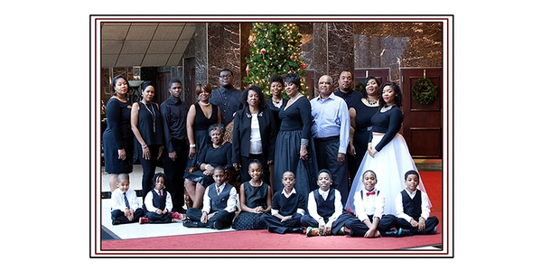 large family dressed in black and white attire for Maryland holiday image.