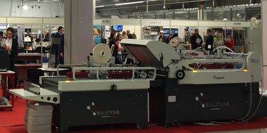 Compact with high pile feeder folding and gluing machine designed for the production of  envelopes