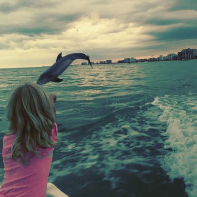 A girl at one of our dolphin tours off the coast of Marco Island, FL