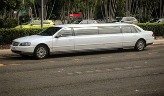 White stretch limousine outside Sunshine Coast Airport.