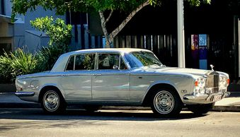 Rolls-Royce Silver Shadow shown against the backdrop of the Seahaven resort on Hastings Street Noosa