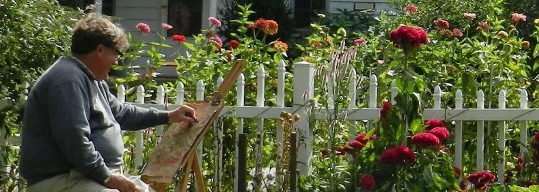 Larry Lerew drawing en plein air in a flower garden. www.LarryLerew.com